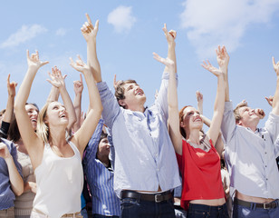 Cheering crowd with arms raised