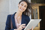 Portrait of smiling businesswoman using digital tablet