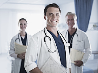Portrait of confident doctors in hospital room