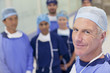 Portrait of smiling surgeons and nurses in hospital