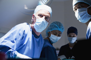 Portrait of surgeons working in operating room