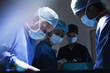 Surgeons concentrating in operating room