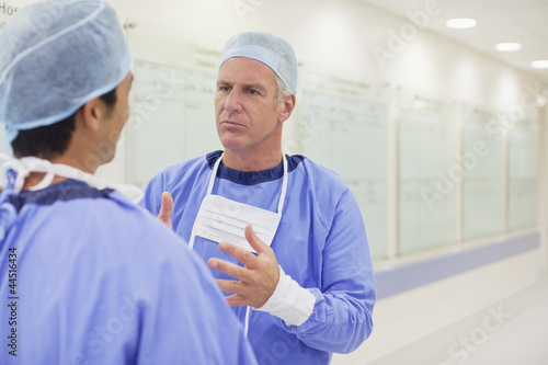 Surgeons talking in hospital corridor