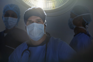 Portrait of confident surgeons in operating room