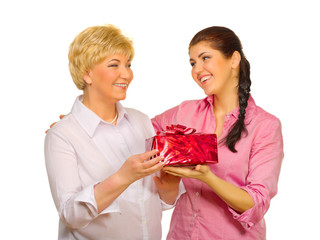 Senior woman giving gift to her daughter