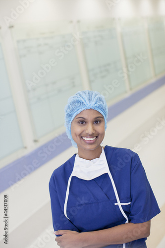 Portrait of smiling nurse in hospital corridor
