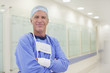 Portrait of smiling surgeon in hospital corridor