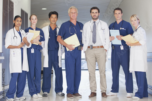 Portrait of confident doctors and nurses in hospital corridor