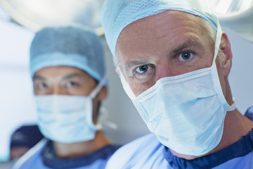 Close up portrait of serious surgeons