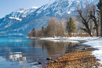 A beautiful lake reflection of the Alps on shore, Interlaken, Sw