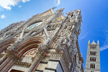 The upper part of the church with tower in Siena.
