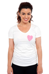 Woman with pink paper heart on her t-shirt