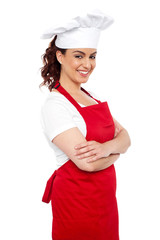 Side view of cheerful chef posing casually
