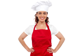 Cure female chef posing with hands on her waist