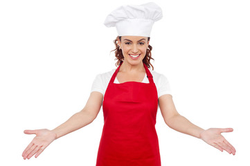Smiling woman chef welcoming you