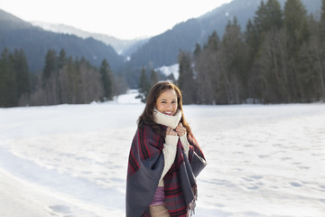 Portrait of smiling woman in snowy field