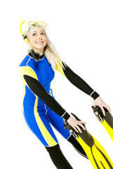 standing young woman wearing neoprene with snorkeling equipment