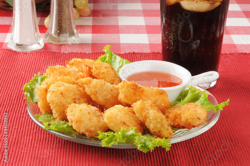 Coconut shrimp and a soft drink
