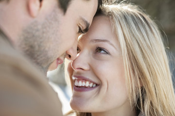 Close up of smiling couple face to face