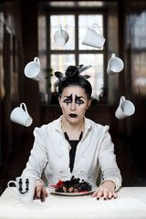Young female with pierrot style makeup