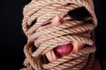 Tied up woman screaming.