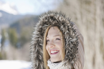 Smiling woman wearing fur hood