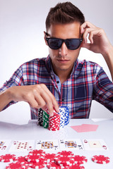 young poker player raises the bet