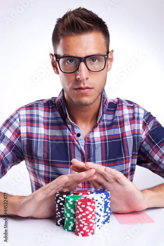 young poker player with eyeglasses going all in