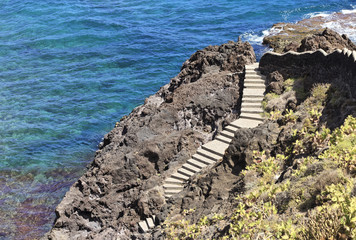 Garrachico, Tenerife, stairs winding down to wild blue ocean