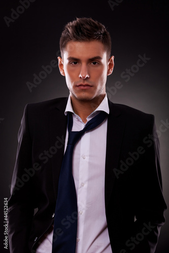 young businessman with loose tie