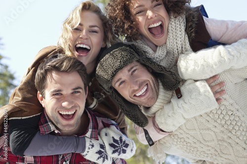 Portrait of smiling couples piggybacking