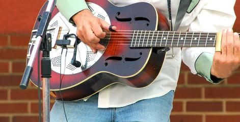 Guitarist performing.
