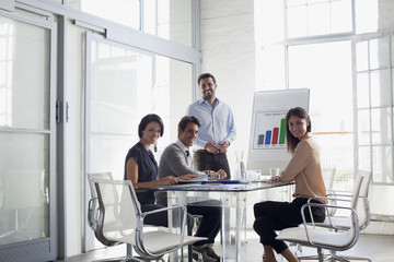 Portrait of confident business people meeting in conference room