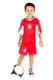 Young football player dressed as Polish national team