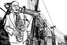 joueur de saxophone dans une rue