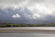 View of sun shining over estuary in Borth Y Gest, North Wales