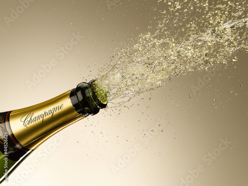 Champagne exploding from bottle
