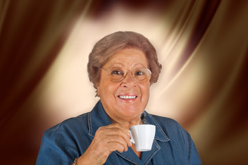 Smiling Grandmother with hot espresso