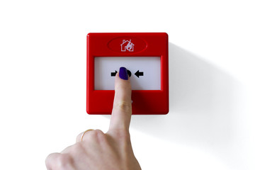 Fire alarm trigger button being pressed by female finger