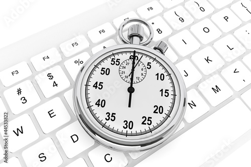 White computer keyboard with stopwatch