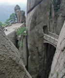 Mountain stone bridge above rocky precipice China
