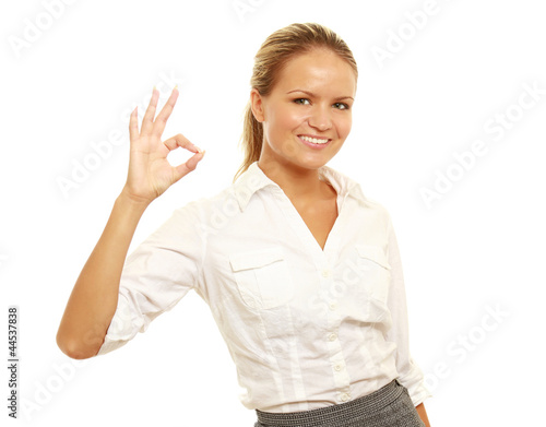 girl doing the okay sign and smiling