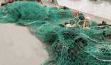 Traditional Sea Fishing Nets on a Harbour Wall. poster