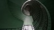 Grunge, green spiral staircase in old, abandoned building