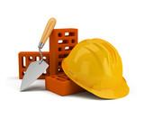 Fototapety helmet with bricks and trowel