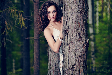 beautiful girl in a wild forest