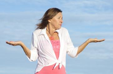 Ignorant, unaware woman gesturing isolated