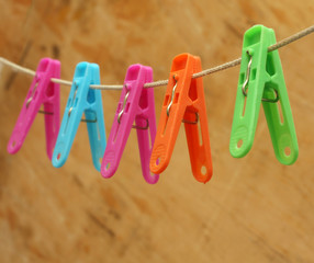 colored clothespins on a wooden background