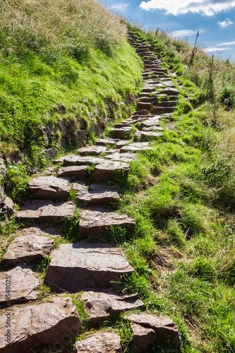 Leinwandbild Motiv Stone path in the mountains leading to the peak