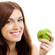 Cheerful woman eating apple, over white